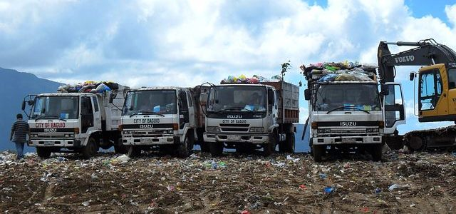 garbage trucks in a dump site