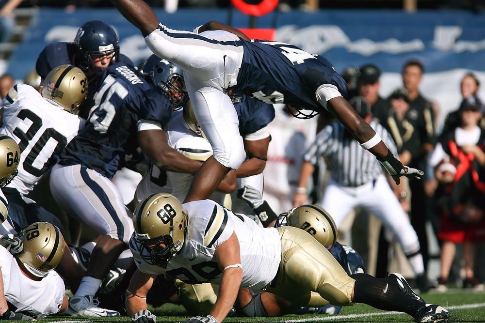 football players clashing