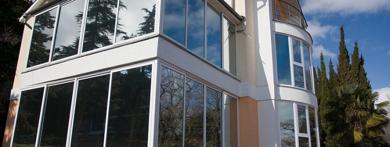 White modern building with privacy film glass windows